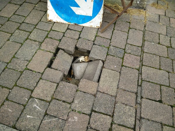 Cross Street Sunken Pavement Hole