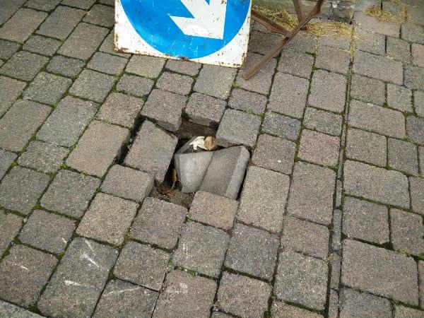 Cross Street Sunken Pavement Hole